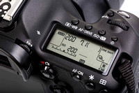 Professional modern DSLR camera - detail of the top LCD with set